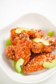 Buffalo wings with a tempura batter and poppy seeds.