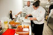 Executive Chef Rachel Cannon, right, and Tin Roof's Corporate Executive Chef Will Zuchman add the finishing touches to their take on buffalo wings with a tempura batter.