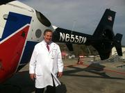 Dr. David Vukich, Shands chief medical officer, stands beside the helicopter that bears his initials in its tail number. Vukich was one of three founders of TraumaOne.