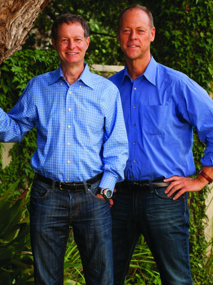 Together, John Mackey and Walter Robb run Whole Foods Market Austin's biggest public company. They faced tough questions from investors after releasing quarterly report that showed the organic grocer missed analysts' expectations.