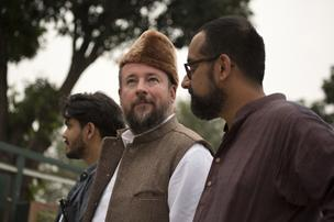 Shane Smith, second from left, and Suroosh Alvi, co-founders of Vice magazine, are seen in this handout photo taken on Oct. 23, 2012.