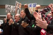 Machinists rally Thursday at the Seattle union hall to vote against Boeing's latest contract offer.