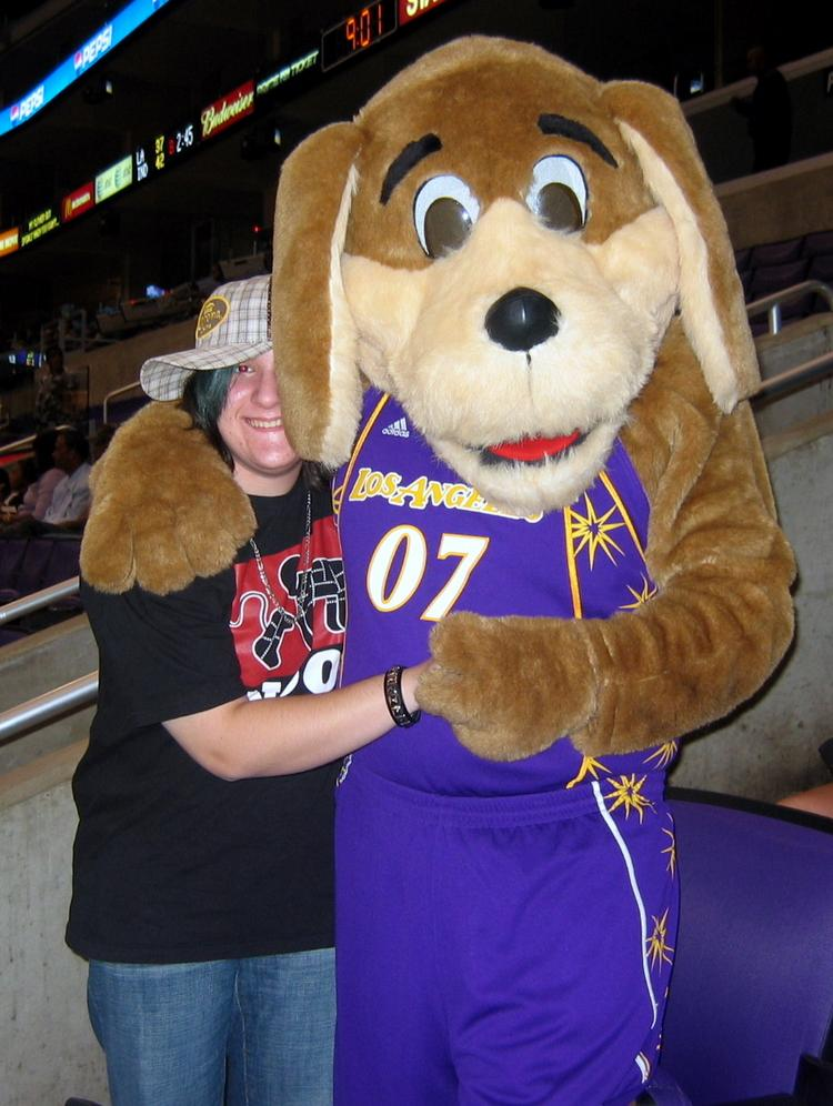 Sparky (right), the Los Angeles Sparks mascot, with a fan.