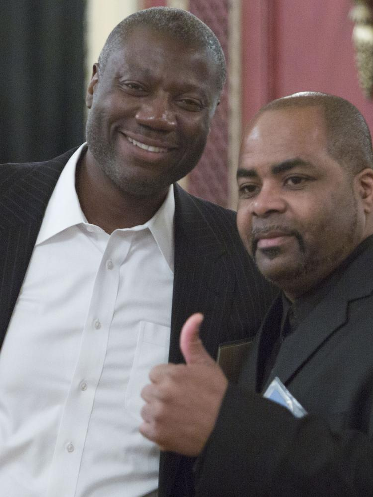 Leon Kinloch, United's former senior vice president for pricing and revenue management (left), is seen with Raymond Jarrell, a United customer service representative. They were among 100 United Airlines employees named for exemplary performance last spring.