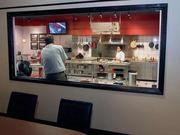 A look from behind glass in an adjoining conference room at the newly renovated kitchen at Vigo-Alessi.