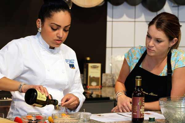 Vigo alessi revamps test kitchen heats up cooking contests tampa lexington college student chef hillary marquez prepares a faro stuffed peppers dish as winner of the forumfinder Image collections