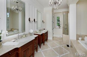 8 Long Meadows Lane: The master bathroom features marble and a shower with body sprays.