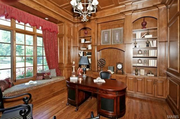 2424 Oak Springs Lane: The paneled library has custom built-ins.