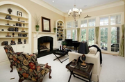 2424 Oak Springs Lane: The great room has 14-foot ceilings, and a fireplace is flanked by arched bookcases.