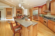 2424 Oak Springs Lane: The kitchen features a butler's pantry.
