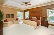 2424 Oak Springs Lane: The master bedroom features his and hers walk-in closets.