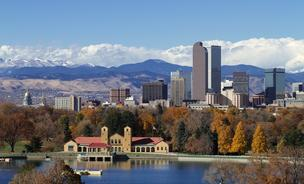 The Denver skyline, with City Park Lake in the foreground.