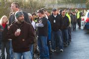 Boeing Machinists line up to vote on the contract proposal Friday outside union hall Everett.