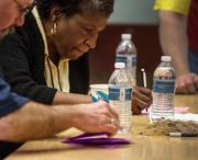 Machinists union members count votes on the Boeing contract proposal at the Seattle union hall.