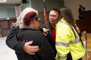 """A disappointed Hazel Powers (center) hugs other members after it's announced the Boeing proposal passed by 51 percent.  """"All the benefits that come along with being in solidarity have been taken away by 51 percent,"""" she sobbed."""