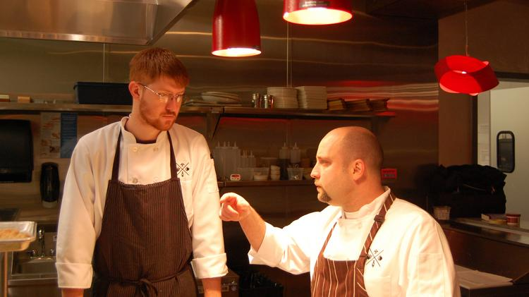 Stagioni Executive Chef Larry Schreiber talks with one of his cooks on Friday.