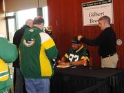 Former Packers player Gilbert Brown signed autographs.