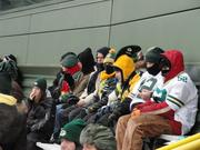 Fans bundled up to sit out in the cold.