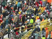 There were many cheeseheads worn during the game.