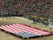 A large flag was featured during the National Anthem.