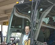 WSU Head Basketball Coach Gregg Marshall smiles Wednesday after boarding the bus to take the team to the airport.