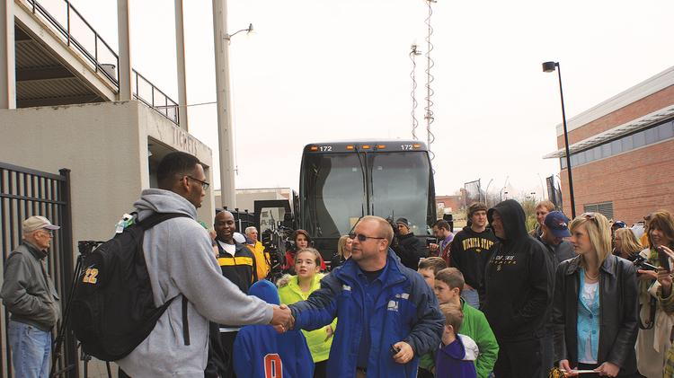 Shocker basketball player Carl Hall accepts well-wishes from fans as he and the team prepare to travel to the Final Four in Atlanta. The work of Hall and others involved in the basketball program has brought greater attention to Wichita, Kansas, and Wichita State University. The Shockers play Louisville at 5 p.m. Saturday. The Wichita Business Journal will report on the Shocker experience throughout the weekend.