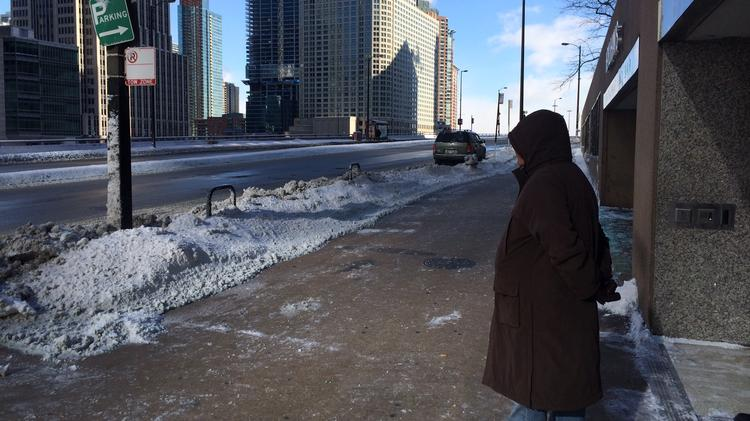 A sole bundled-up observer surveys a deserted Wacker Drive near North Michigan Avenue on a frigid Monday morning.