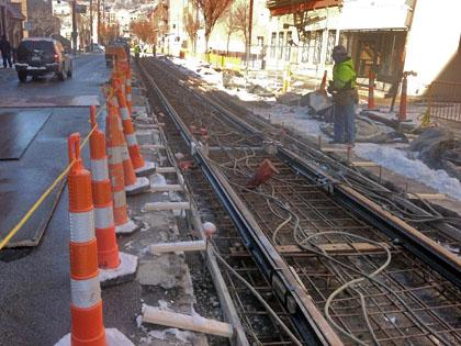 Rails were in place on Friday along Elm Street just north of Findlay Market. A heating system was put in place so concrete could be poured on Saturday.