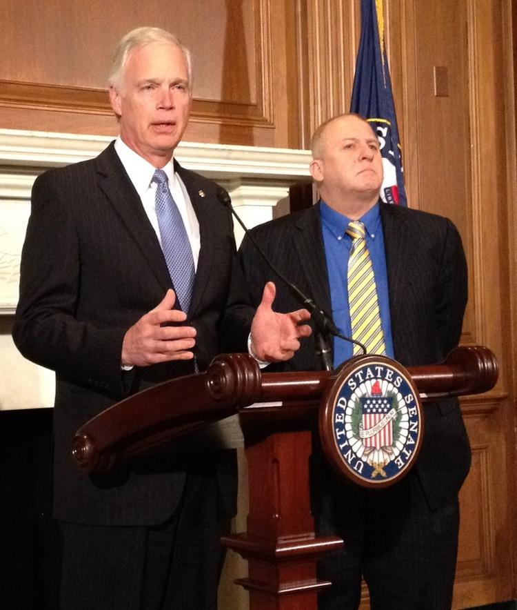 Sen. Ron Johnson, R-Wis.., left and Rick Esenberg, president of the Wisconsin Institute for Law & Liberty, discuss the senator's lawsuit challenging government health insurance subsidies for members of Congress.