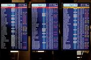 Tale of woe: Flight cancellations mount at Boston's Logan airport Monday.