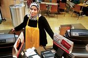 Aicha El Asli, a cashier at Au Bon Pan in Logan's Terminal C was a cheerful purveyor of soup, sandwiches, coffee and pastries to exhausted travelers Monday.