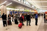 Lines of delayed travelers wended their way through Logan's terminals Monday.