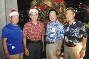 Bank of Hawaii executives, from left, Alton Kuioka, vice chair; Bub Wo, member of the board of directors; Peter Ho, chairman, president and CEO; and Wayne Hamano, vice chair and chief commercial officer pose for a photo in front of a 12-foot decorated Christmas tree outside Bank of Hawaii's main branch in Downtown Honolulu. The tree was later donated to the Institute for Human Services.
