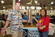Central Pacific Bank Executive Vice President Bill Wilson, left, and Ewalani Dayton, vice president of Easter Seals Hawaii, show off the bank's gingerbread model of Aloha Tower at the Easter Seals Hawaii Gingerbread Family Festival 2013 at the Neal S. Blaisdell Center last month.