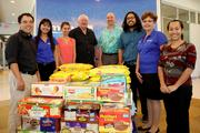 Hawaii Medical Service Association employees on Oahu, Maui, Kauai and the Big Island collected a total of $35,000 and 5,000 pounds of canned food for the Hawaii Foodbank during a four-week holiday food drive. From left, HMSA team members Daniel Isobe, Monique Noe, Zoe Abrams, Hawaii Foodbank President Dick Grimm, HMSA President and CEO Mike Gold, Bronson Kiko, Margaret Agustin and Courtney Oyama.