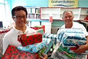 The Graham Builders team wrapped more than 100 holiday gifts for the children and families of the Hawaii Children's Cancer Foundation before the annual holiday party at Kapiolani Medical Center for Women and Children. From left, Evan Fujimoto, president of Graham Builders, and Danny Graham, CEO of Graham Builders.
