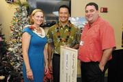 From left, Martha Smith, CEO of Kapiolani Medical Center Women & Children; Todd Apo, director of public affairs at Aulani, A Disney Resort & Spa; and Ray Vara, CEO of Hawaii Pacific Health, at a presentation by Aulani, A Disney Resort & Spa, of $250,000 to the Kapiolani Health Foundation in support of a play area to be built in the neonatal and pediatric intensive care unit building.