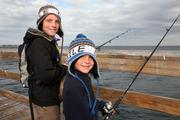 Dylan Carne and Ayden Carne from Wesley Chapel braved the cold wind to fish at The Pier in St. Petersburg.