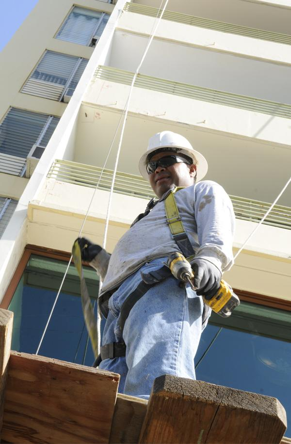 Ben Ifamilik works on the exterior of the Waikiki Grand Hotel at 134 Kapahulu Ave. for Seal Masters of Hawaii. The 18-month project will include full exterior renovation, concrete repair work, painting and waterproofing and making the exterior of the building water-tight, according to Eric Thor, vice president of Seal Masters of Hawaii.