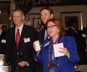 Tom Tschopp of Schafer Tschopp Whitcomb Mitchell; Clay Worden of McGladrey; and Orange County Comptroller Martha Haney listen as the speakers address the audience.