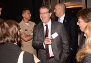 Waymon Armstrong, president of Engineering & Computer Simulations, chats with fellow guests.