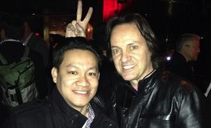 CNET reporter Roger Cheng posing with T-Mobile CEO John Legere at the AT&T event at the Consumer Electronics show in Las Vegas.