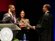 Atlanta City Council President Ceasar Mitchell takes the oath of office for Atlanta city council from the honorable Steve Jones, U.S. district court judge.