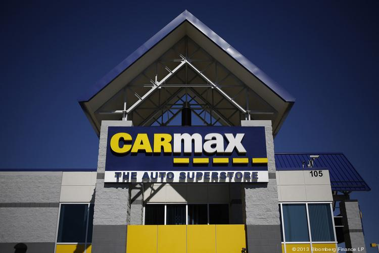 A CarMax sign hangs on the front of a dealership in Lexington, Kentucky. With a dealership planned for Colonie, CarMax is making its entrance into the greater Albany, NY, market.
