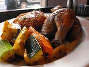 Roasted half chicken with vegetables and potato cakes at Claim Jumper.