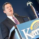 As Brownback touts anti-abortion law, AG prepares to defend it