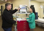 Emergency room director Richard Burton, left, and Apollo Hospital CEO Fawn Creighton touch base at the opening of the facility on Jan. 6.