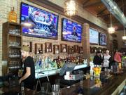 A view of the main bar with some of the many TVs available for watching.