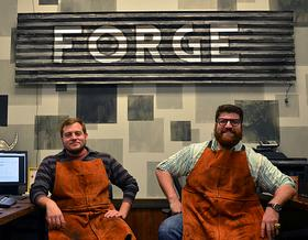 Adam Dukes, left, and Bryce Pfanenstiel, right, sit in their 3D printing company, Forge 3D Printing Studio, on Tuesday, Dec. 31, 2013.
