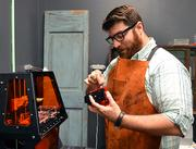 Bryce Pfanenstiel prepares for 3-D printing at his company, Forge 3D Printing Studio.